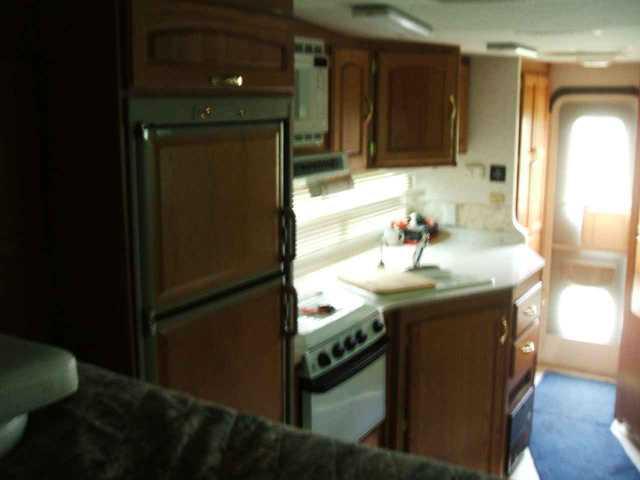 2002 Used Fleetwood Caribou Truck Camper in Michigan MI