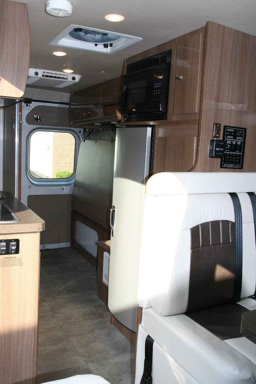 New Additional Sleeping Space Is Available With The Rear Corner Bed And Front Studio Loft Bed A Midcoach Lshaped Galley Is Full Featured And Has A Forward Facing Sink The Travato Is The Latest Class B Motorhome To Join The Winnebago