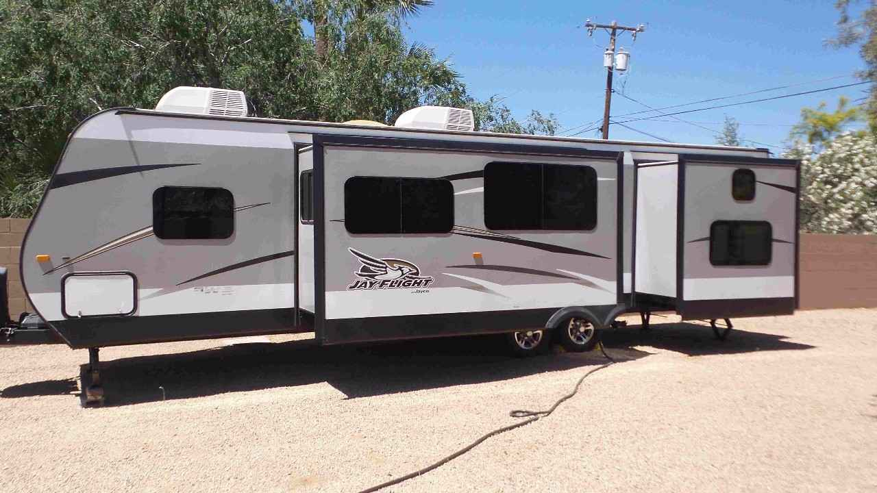 Unique If You Are Looking For A Travel Trailer With All Of The Latest Amenities Then You Have Found It In The Jay Flight 34RSBS Travel Trailer By Jayco To The Left Of The Entrance There Is A Slide With A Dinette Or An Optional Table And Chairs, And